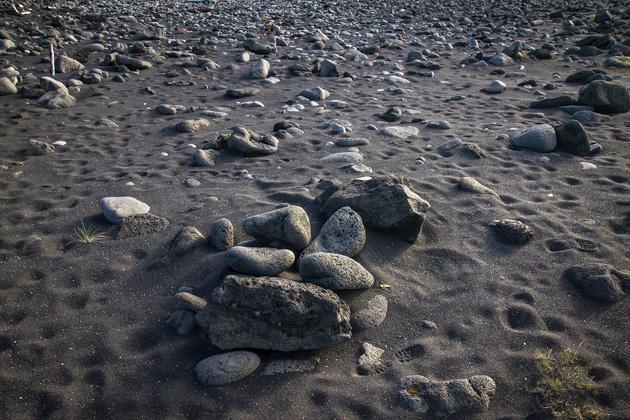 Black Stone On Black Sand