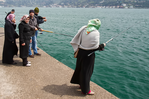 Woman Fishing In Istanbul