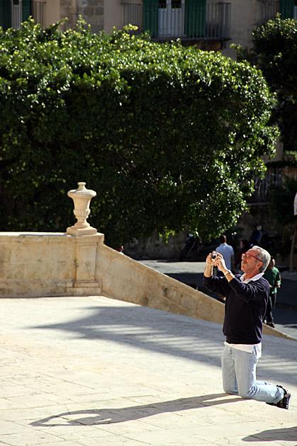 Praying Photographer